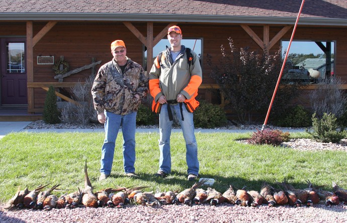 Steve owner of Antler Ridge Lodge and Ryan of 3plains on the pheasant hunting opener.