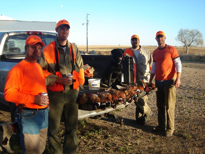 2007 South Dakota pheasant hunting opener with UGUIDE. We saw a high number of birds and had a great hunt. L to R: Roger, Ryan, Peter, and Joe.